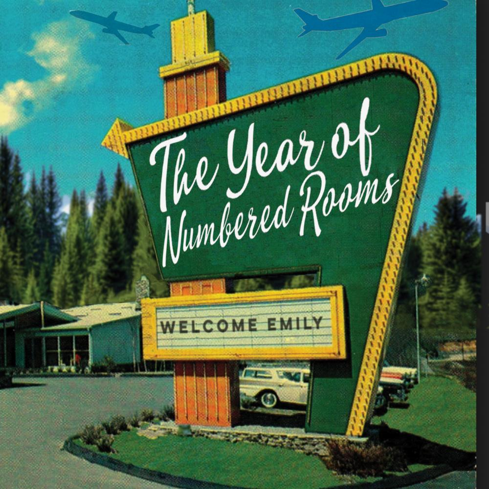 "A green motel sign with the phrase, ""The Year of the Numbered Rooms"" written on it."