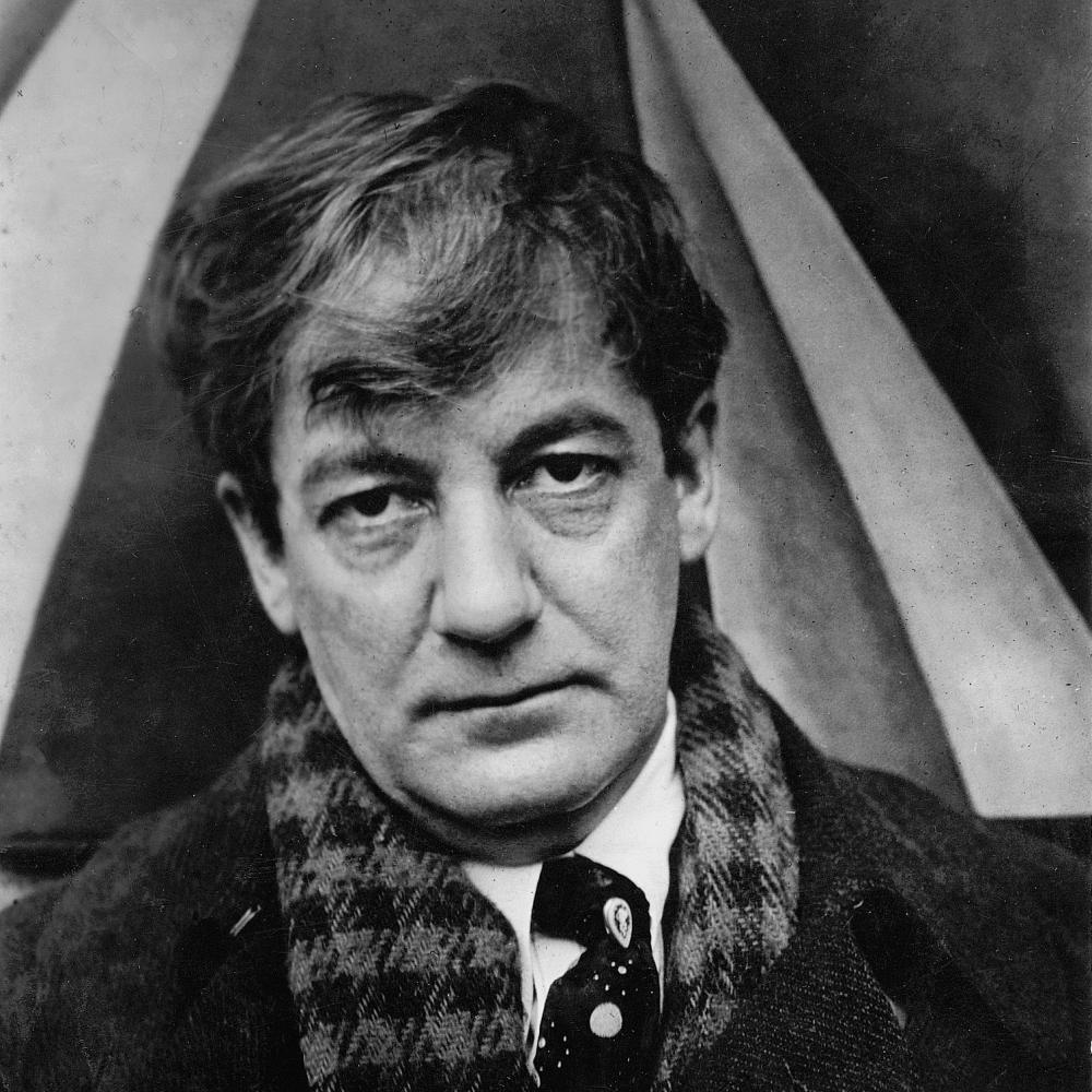 Black and white photograph of Sherwood Anderson, wearing a checkered scarf