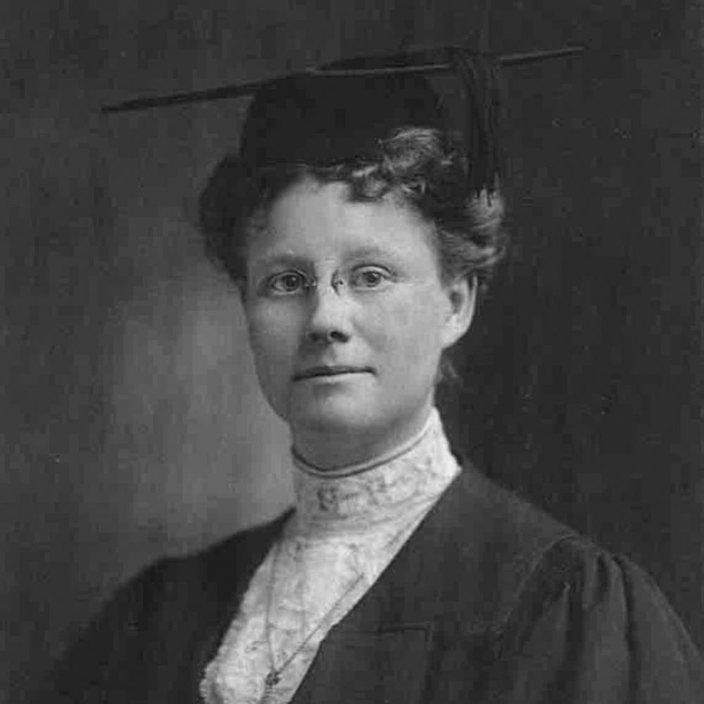 Formal portrait of Dr. Darrow, wearing a pair of small eyeglasses, black dress and lace collar