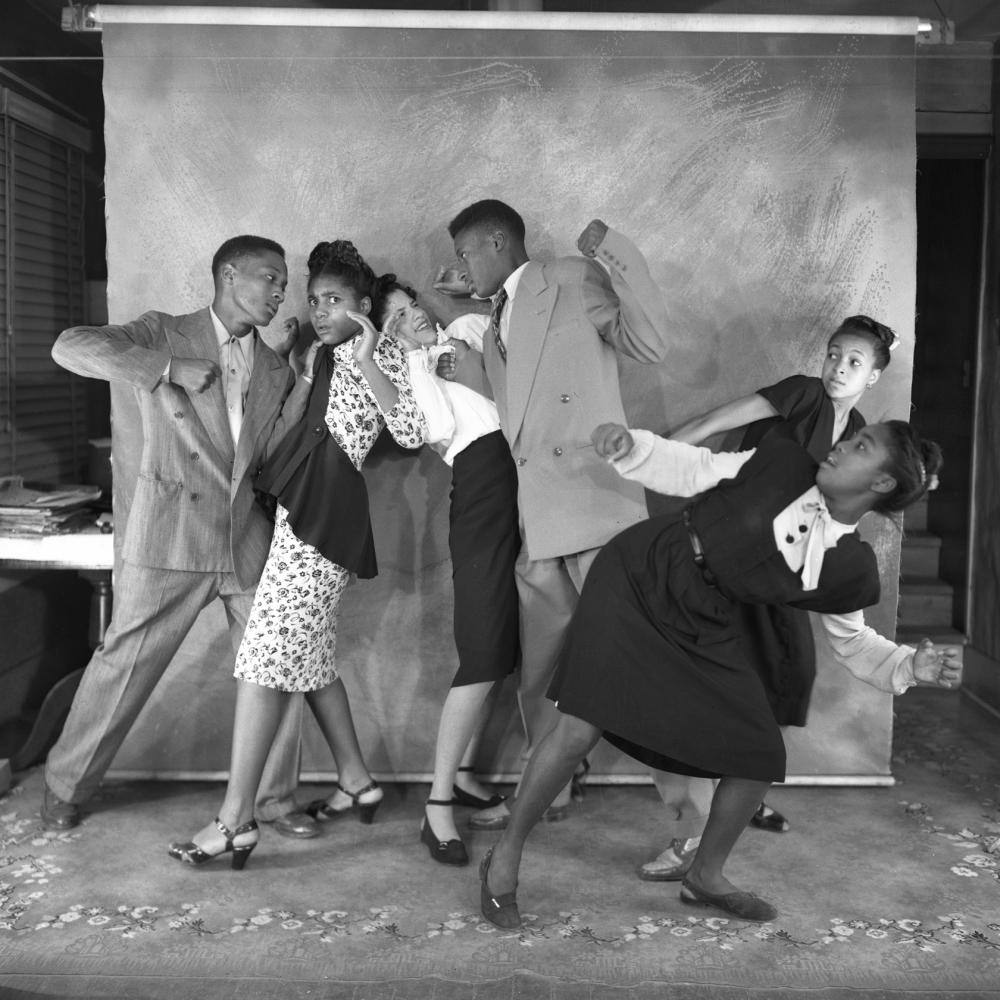 Black and white photo of several African Americans performing as pantomimes.