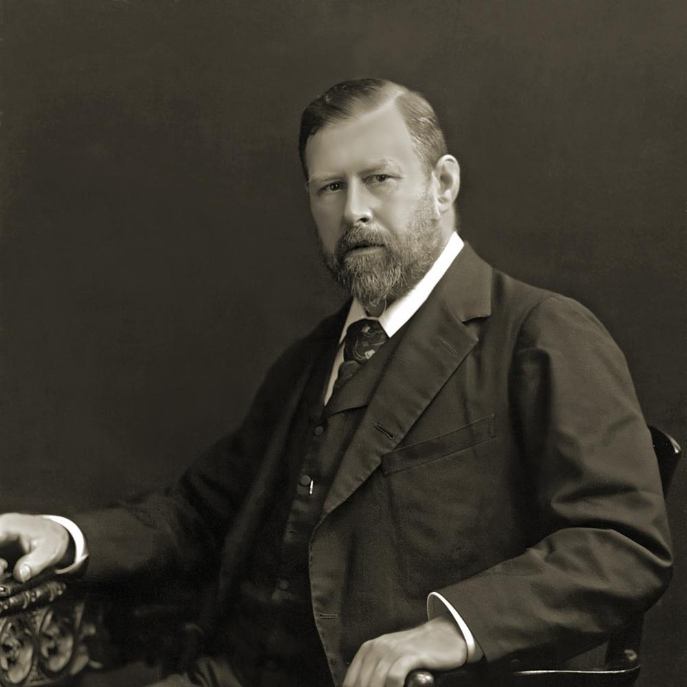 Black and white photo of Bram Stoker sitting in a chair.