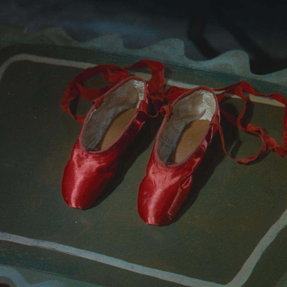 Movie still of red satin ballet shoes