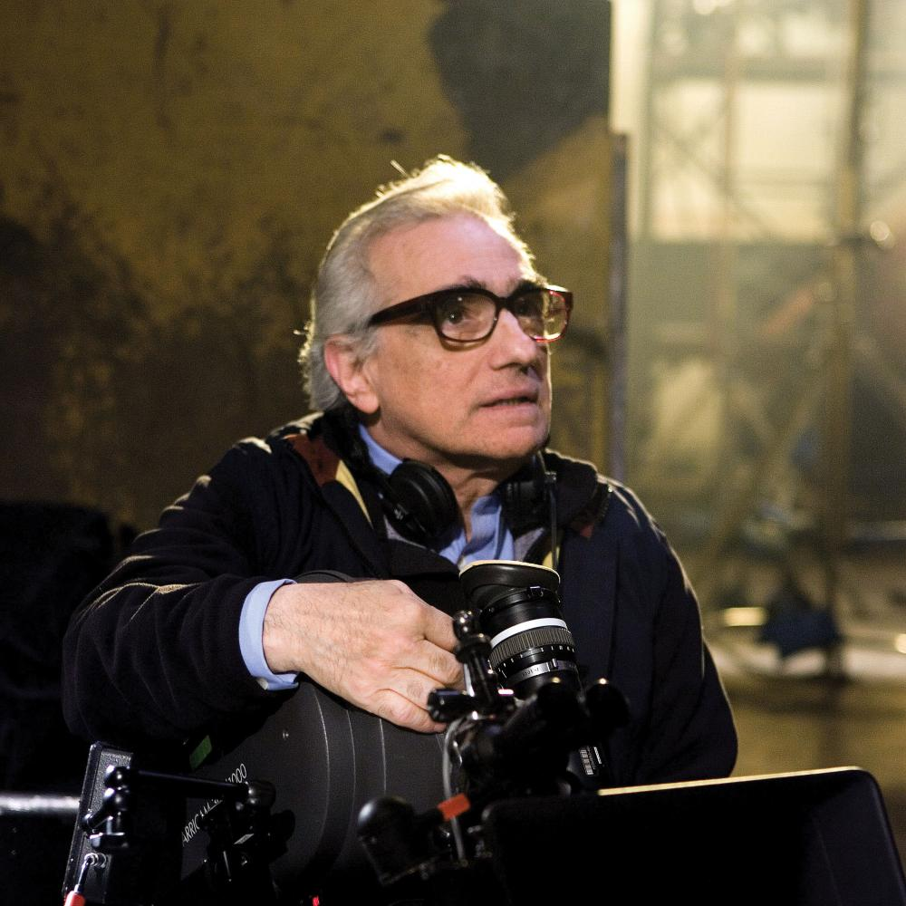 Photograph of martin scorsese with headphones around neck
