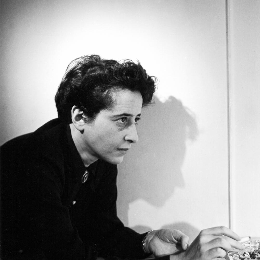 the trial of hannah arendt  national endowment for the humanities neh arendt with short dark hair holding a cigarette leaning on a countertop  and