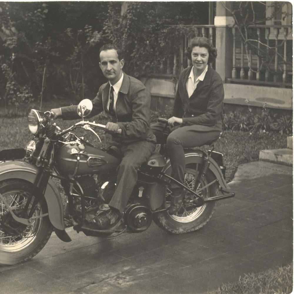 Boggs and Don Pepe, sitting on a motorcycle