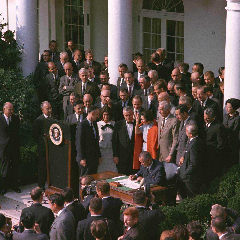 Color photo of the ceremony where President Lyndon Johnson signed the NEH into law.