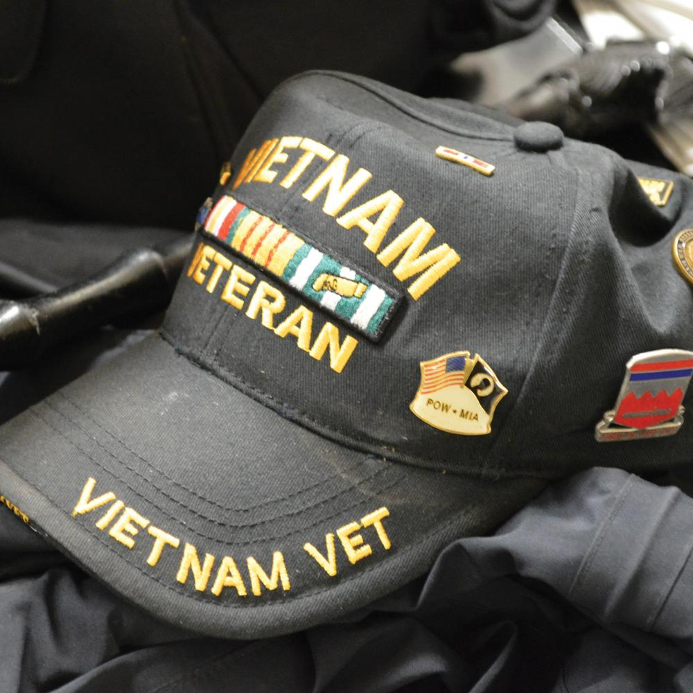 "Color photo of a black baseball cap that says ""Vietnam Veteran"" on it."
