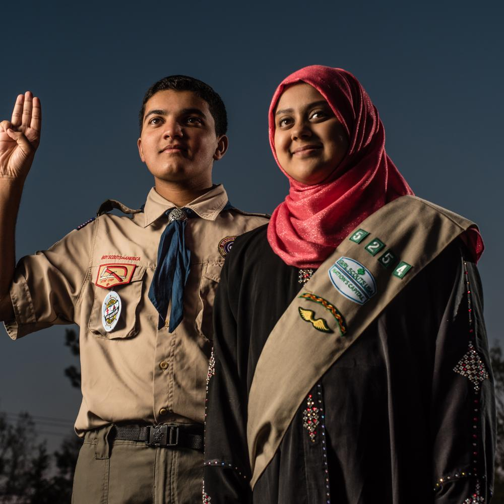 Photograph of girl and boy in scout uniform