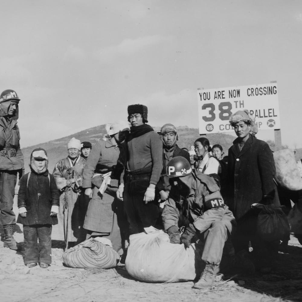 Refugees are checked for contraband by U.S. soldiers at 38th Parallel in 1950