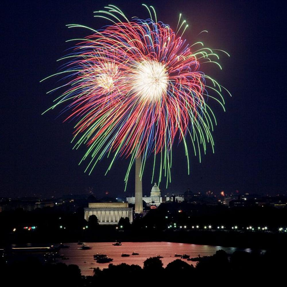 An explosion of fireworks against the night sky above the national mall in Washington, D.C.