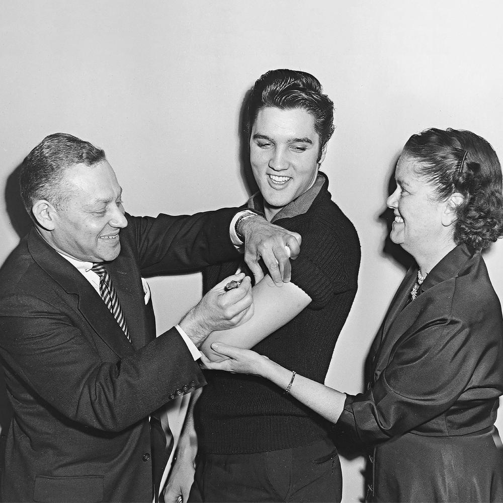 Elvis Presley receiving the polio vaccine.