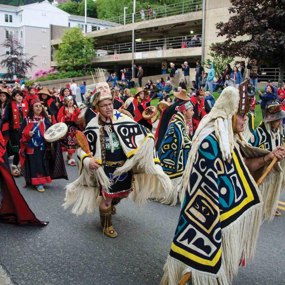 The Cape Fox Dancers in colorful traditional gard and headwear at the Sealaska Heritage Institute Celebration in 2014.