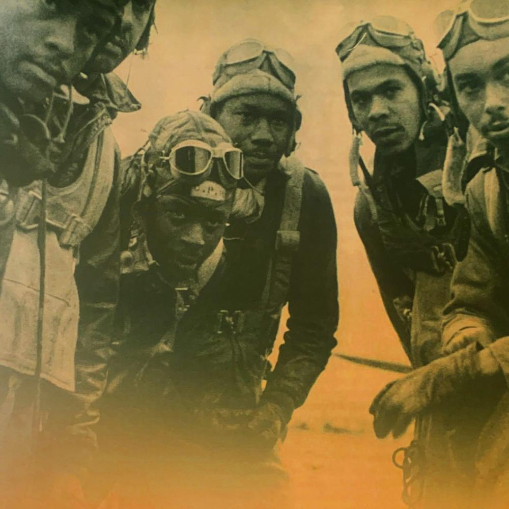Black and white photo of six Tuskegee Airmen in Italy.