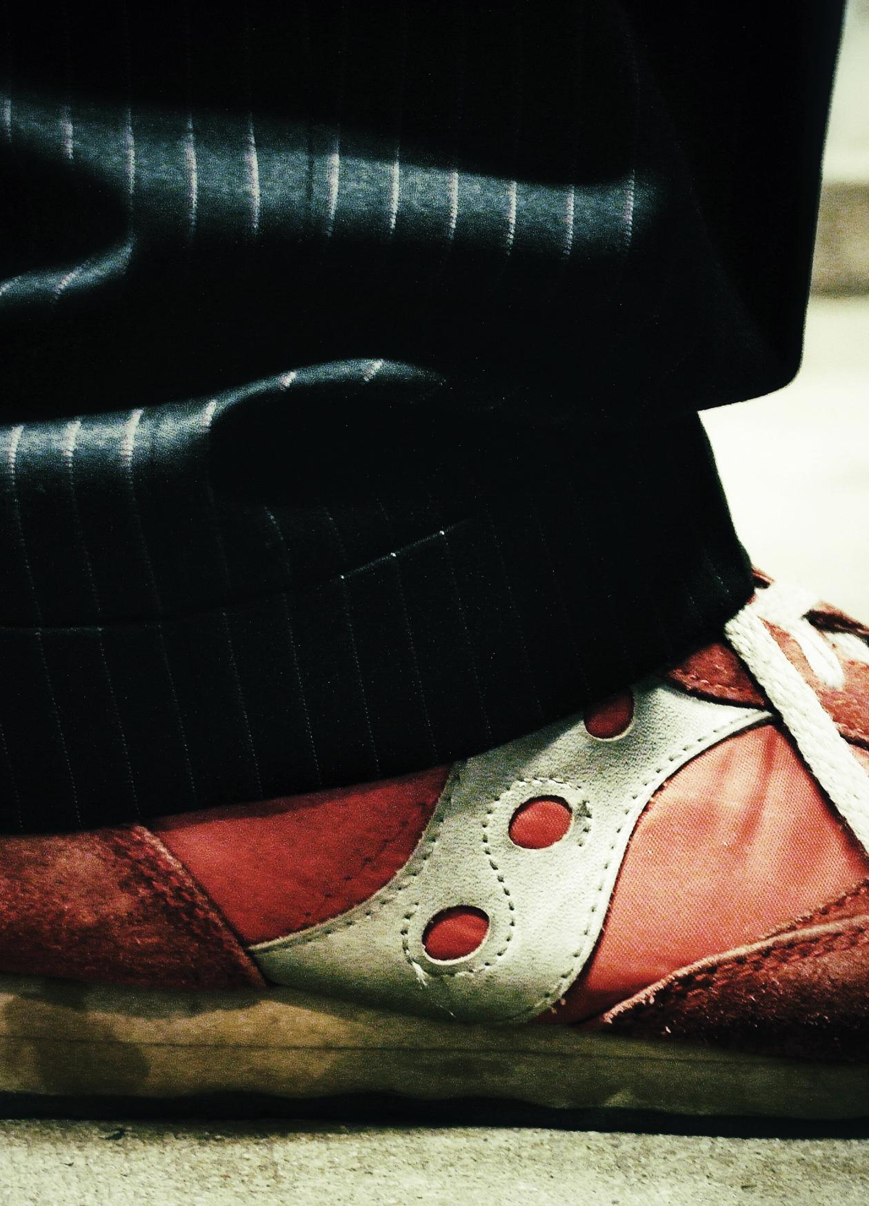 View of Garrison Keillor's shoes, red and grungy.