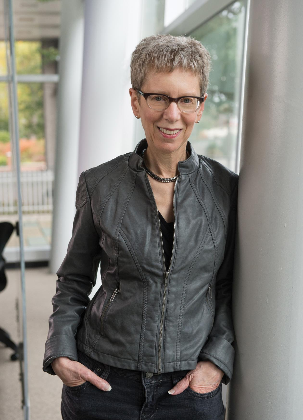 Terry Gross, standing with her hands in her pockets