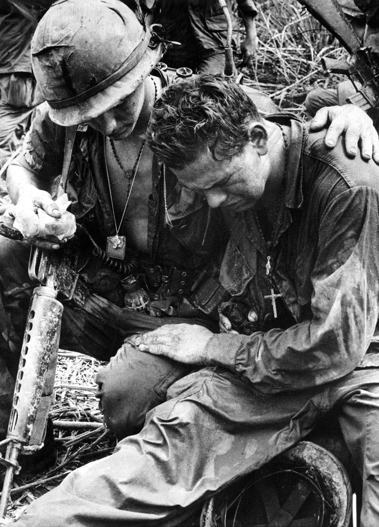 Black and white photograph of two American soldiers in Pleiku, South Vietnam