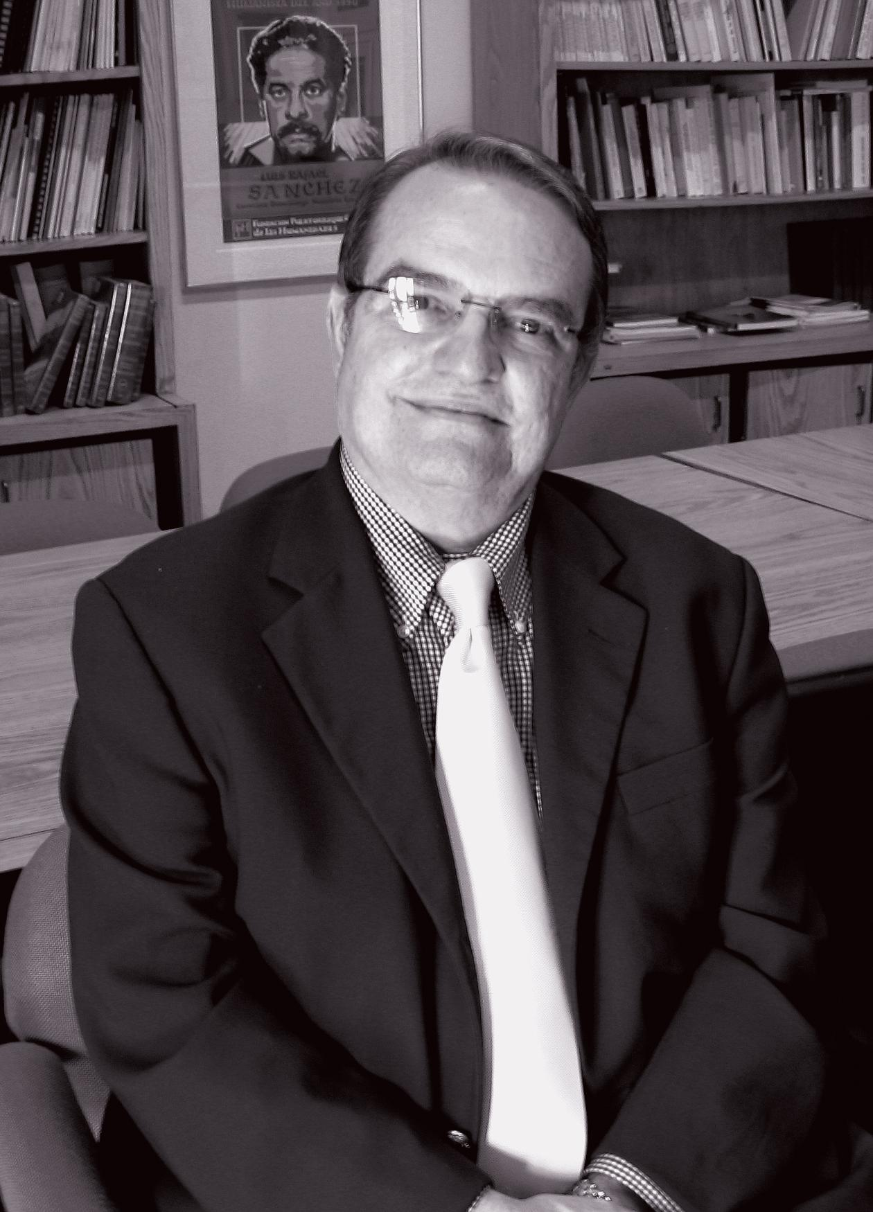 black and white photo of a man in a suit with glasses