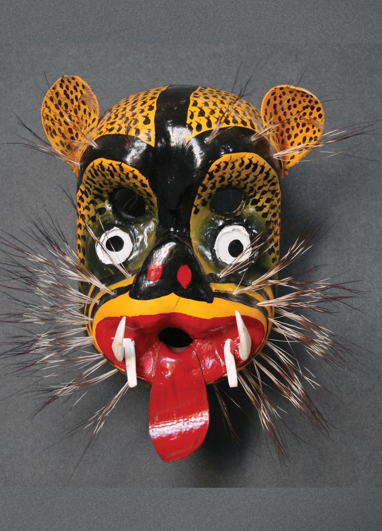 Photograph of a wooden mask, colorful