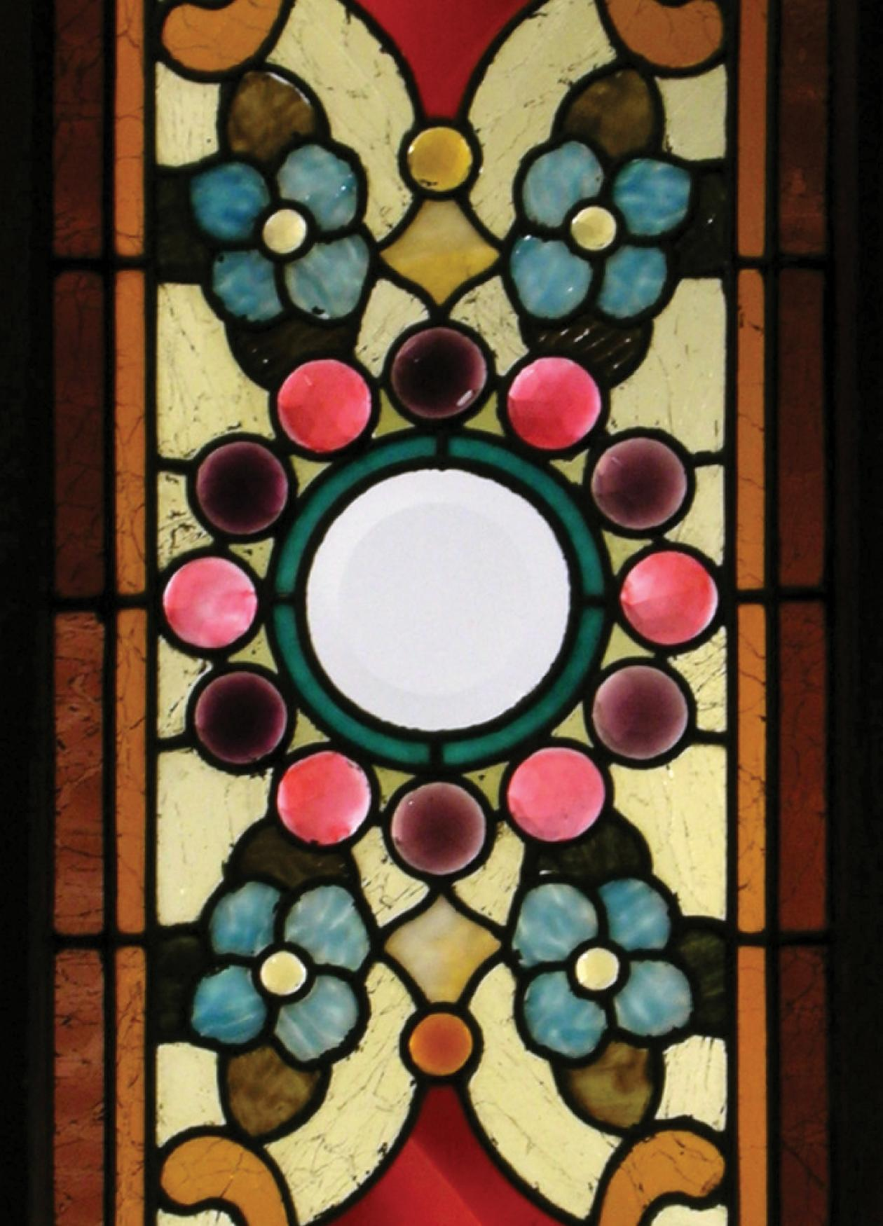 Panel of colorful stained glass in a floral pattern