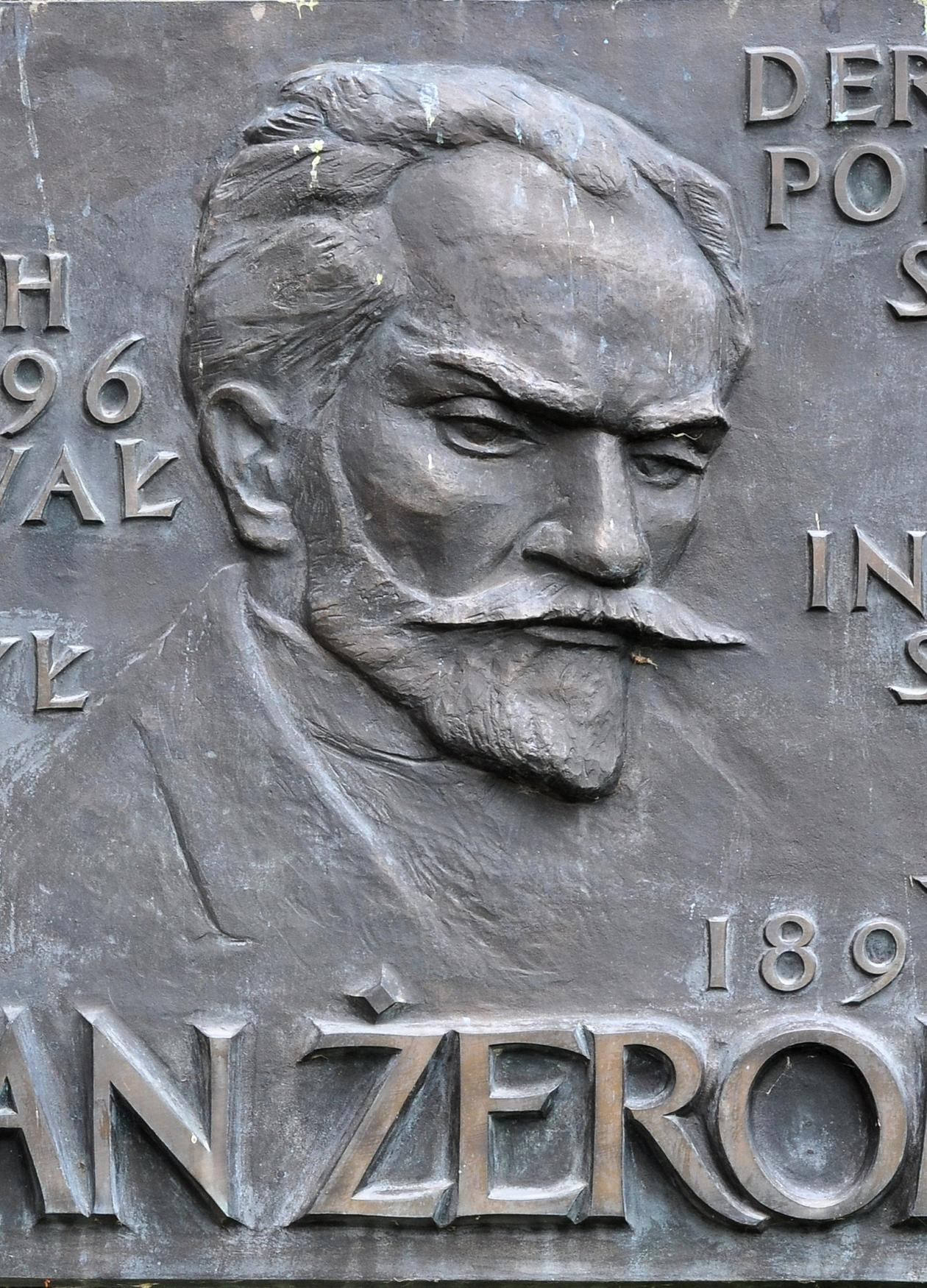 Grey engraved plaque of Stefan Zeromski.