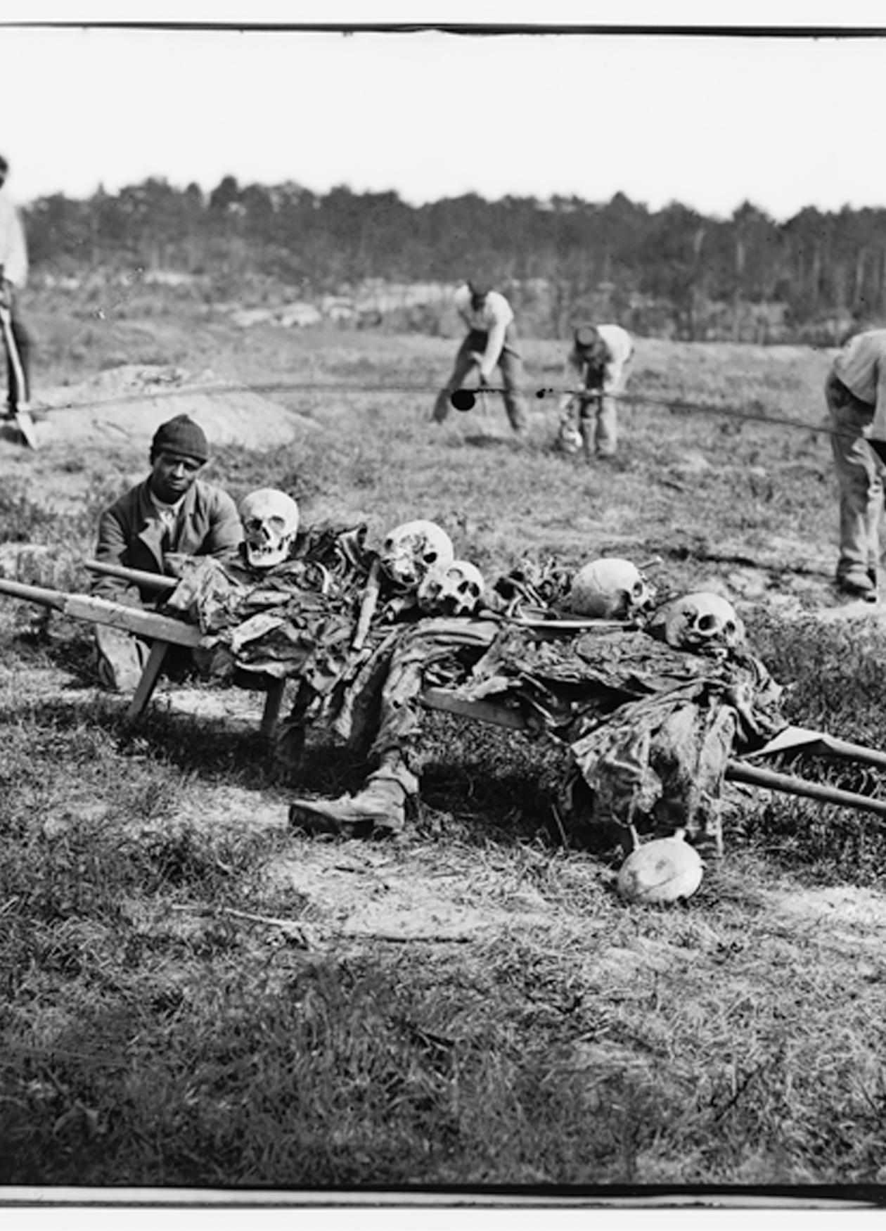 Black and white photo of African Americans carting off the bones of casualties from the Battle of Cold Harbor.