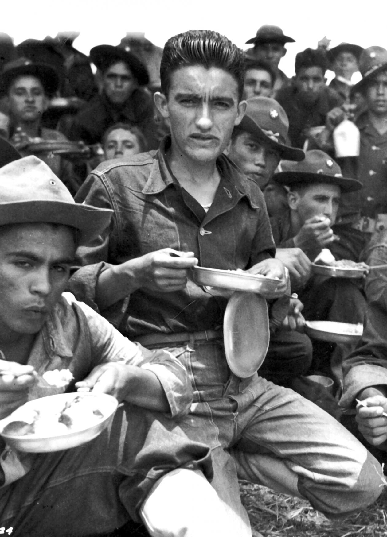 Group of Latino American soldiers sitting and resting between training maneuvers