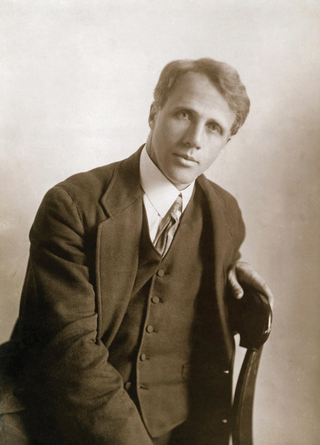 Sepia-colored photograph of a handsome Robert Frost in suit and tie.