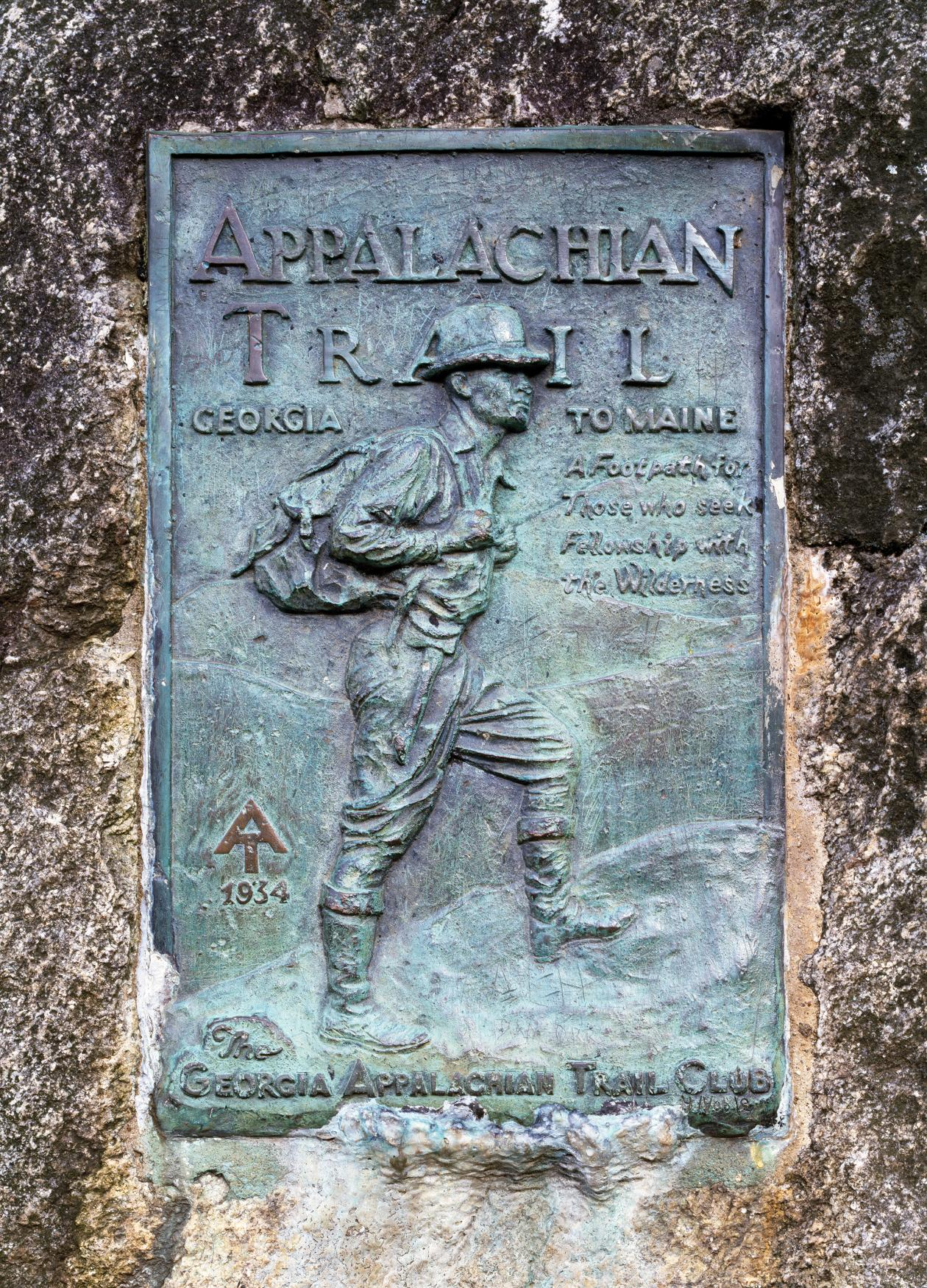 Photo of a dark green plaque which marks the beginning of the Appalachian trail.