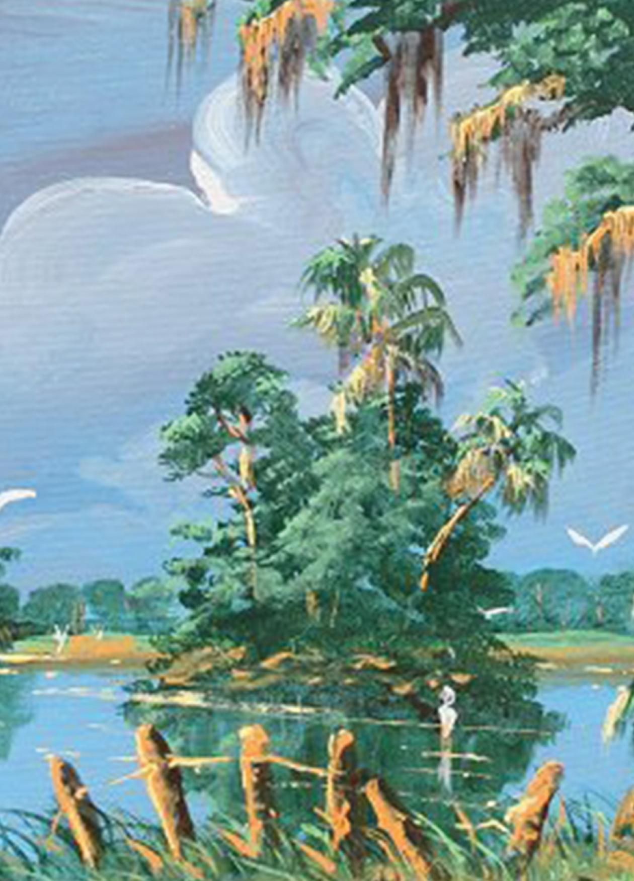 Tropical lagoon, blue water, lush trees, with an island in the center of the water