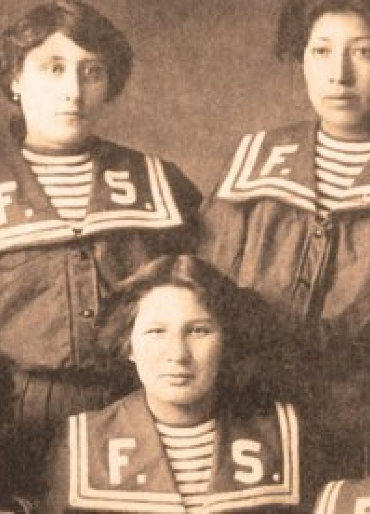 Sepia-colored photo of a team of women basketball players.