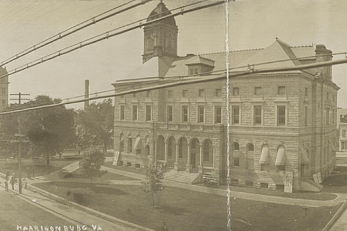 Postcard showing Rockingham County courthouse and surrounding buildings in Harrisonburg, Virginia.