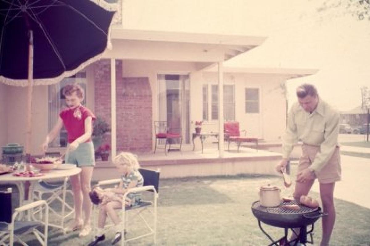 Family barbecue in Lakewood Plaza suburban development, Long Beach, California,