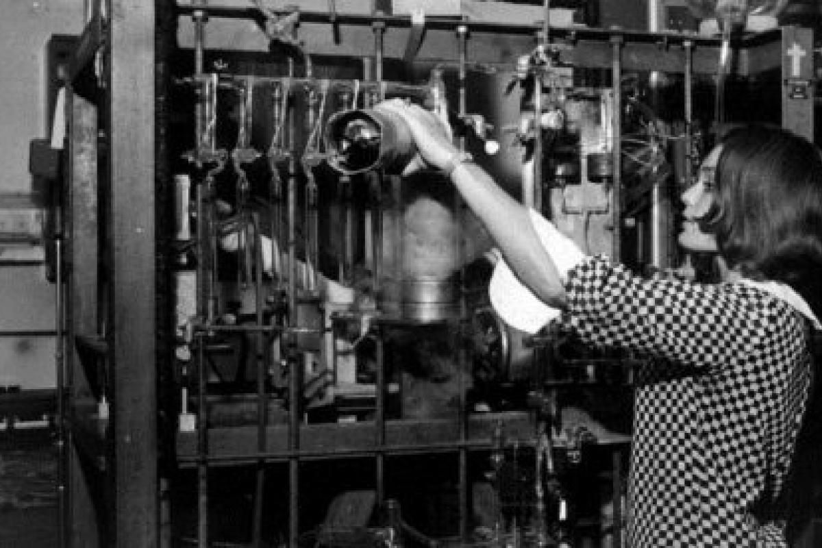 Young woman working with scientific equipment.