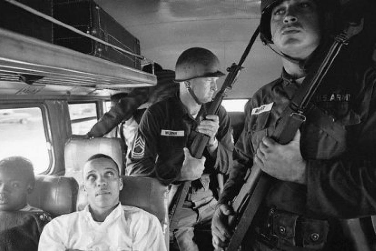 Members of the U.S. Army escort Freedom Riders