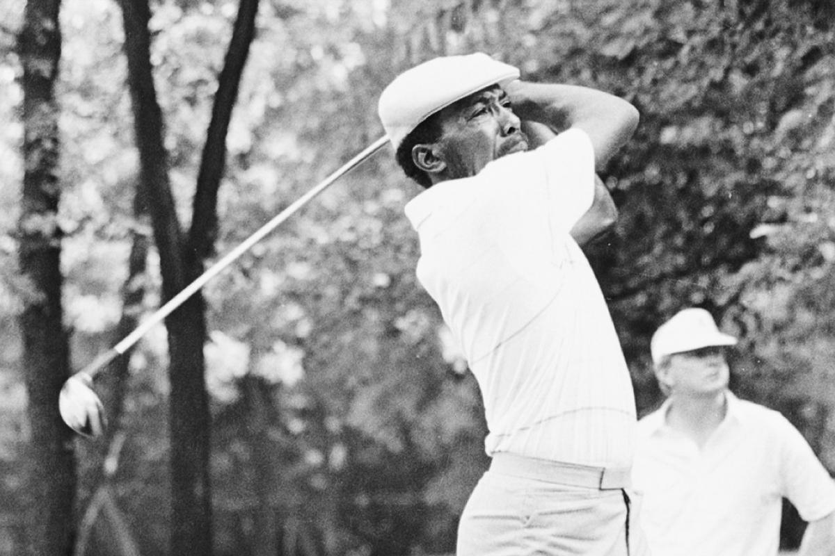 Black and white image of Calvin Peete swinging golf club