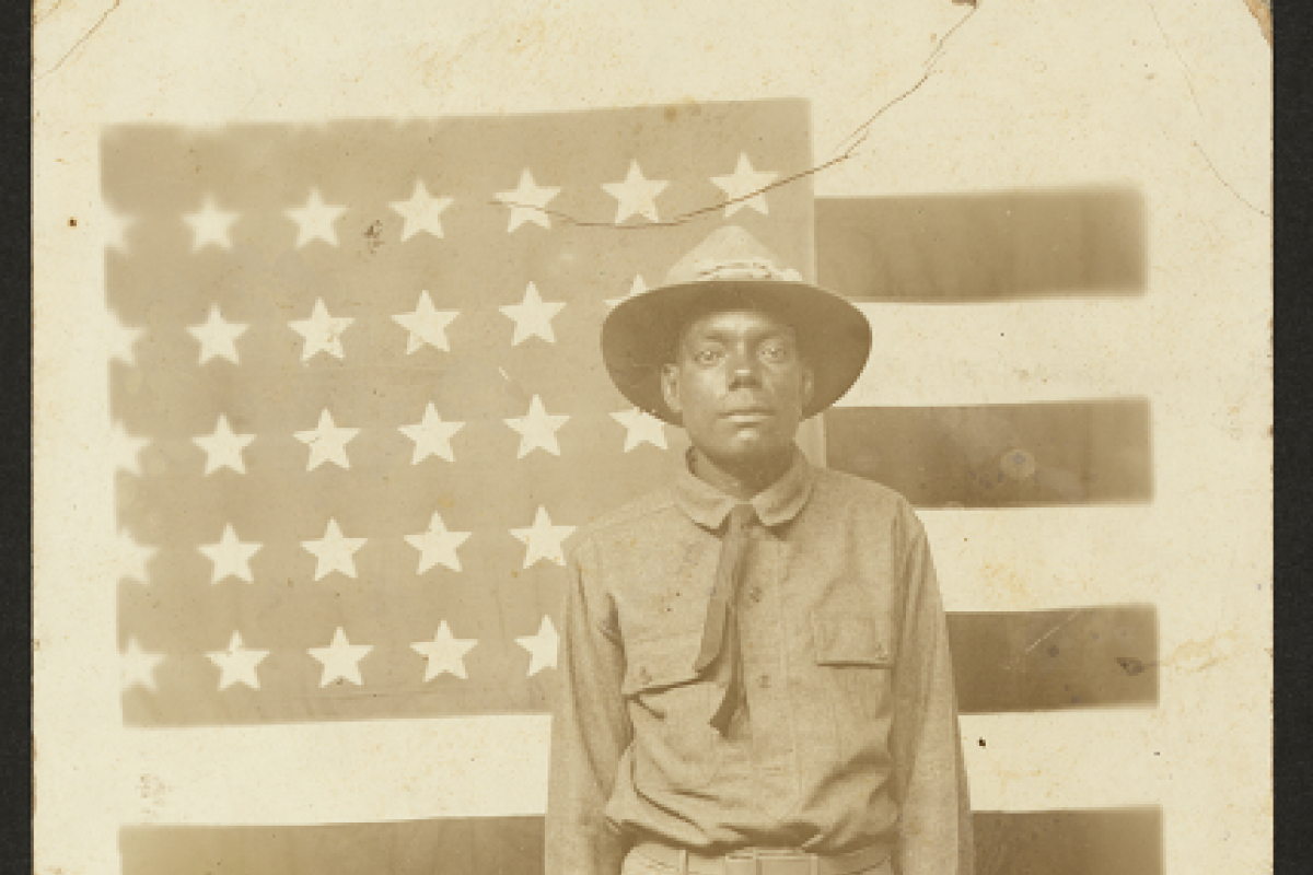 American soldier in front of an American flag, WWI