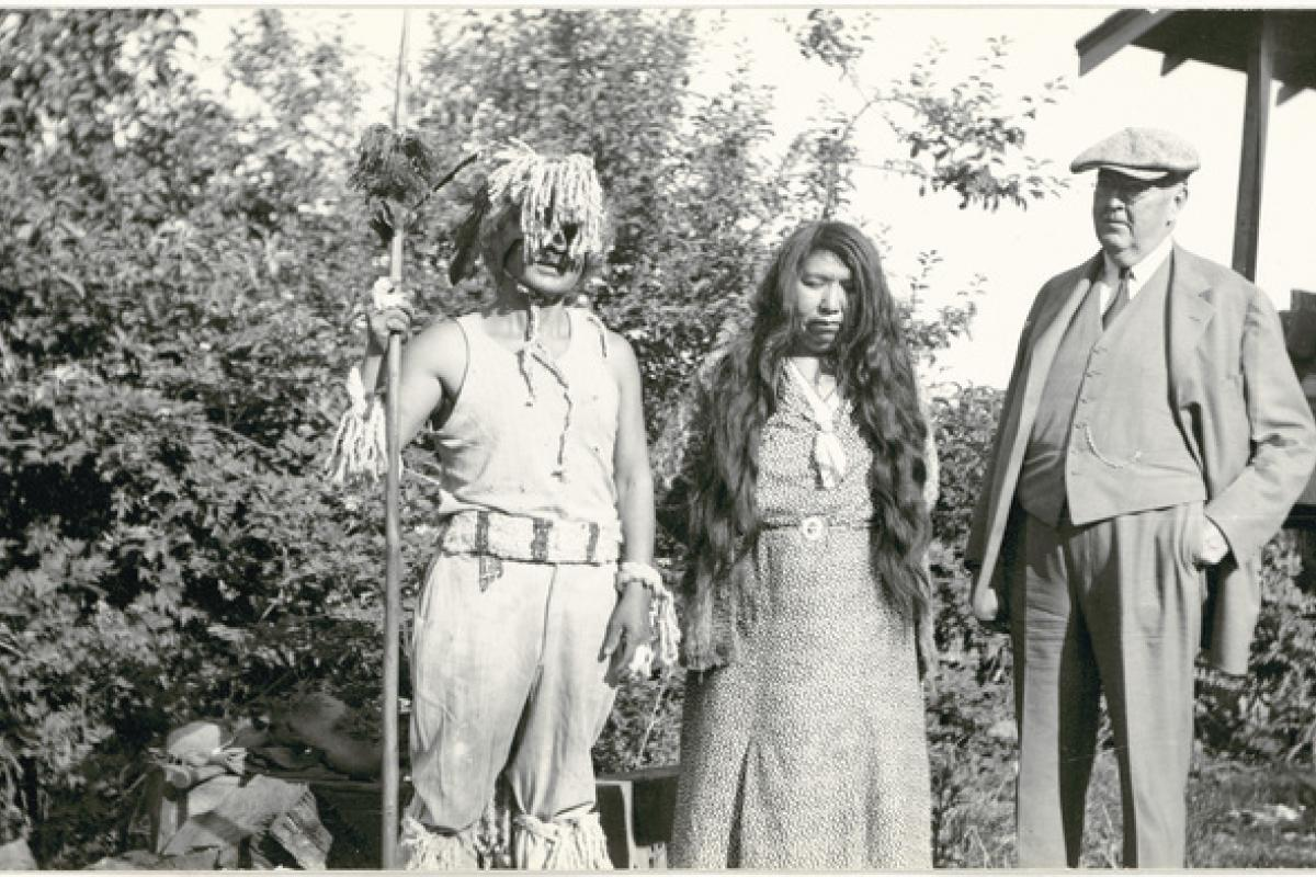 Black and white photo of two Saanich people with George Heye