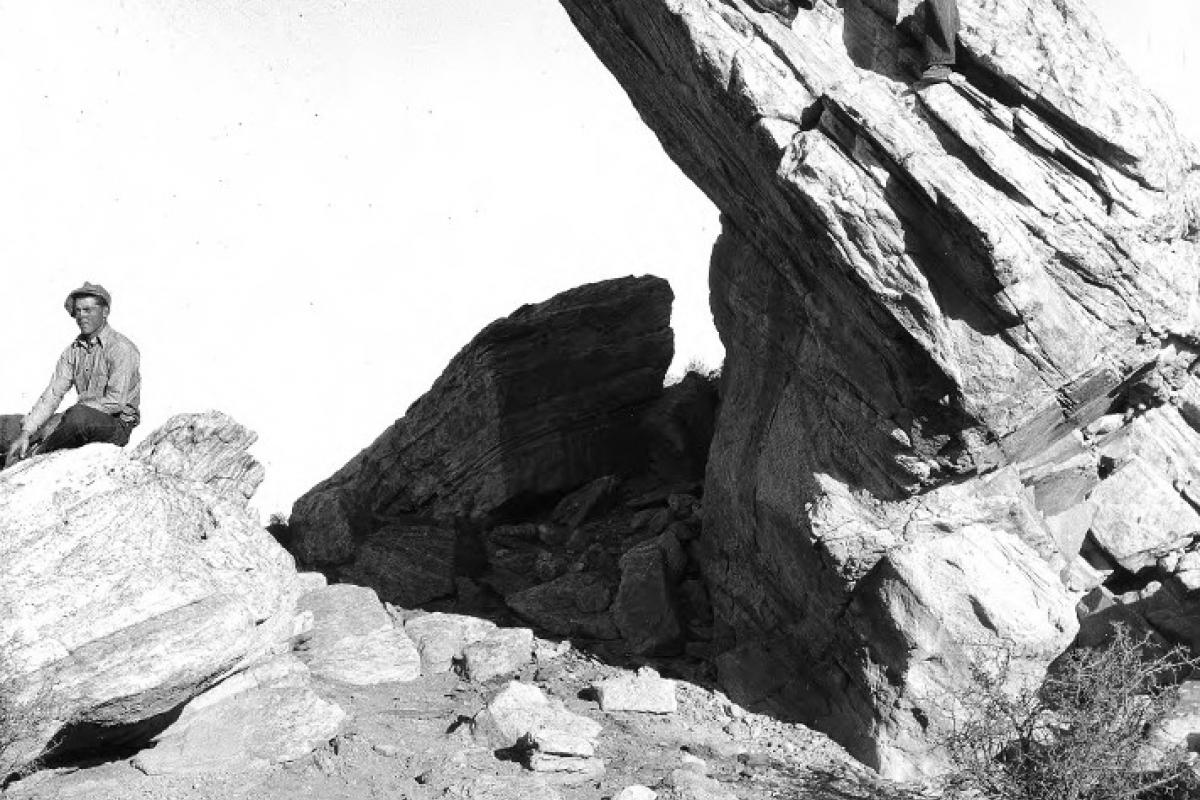 Two men climbing rock formations
