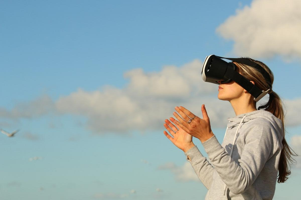 Woman wearing virtual reality glasses looking at the clouds