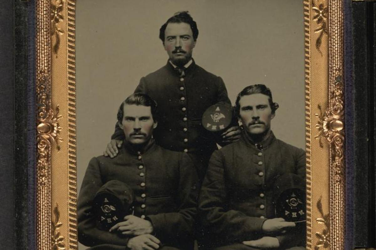 Photo portrait of three brothers from the Civil War in Union uniforms