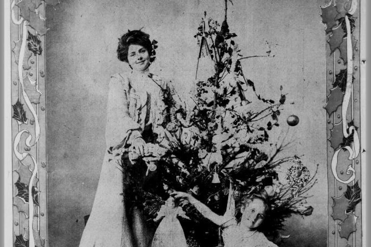Woman and child by Christmas tree