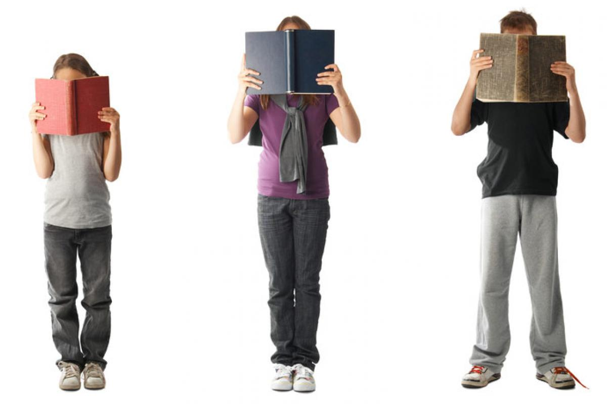 photo: three kids holding books