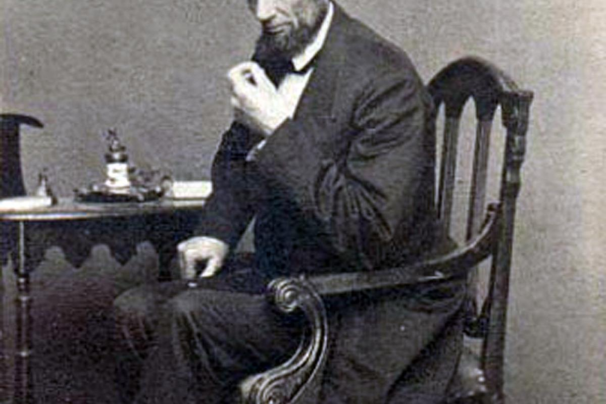 Photo of Lincoln seated by Matthew Brady