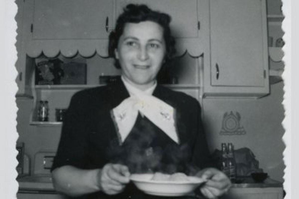 black and white photo of woman holding matzah ball soup, 1954