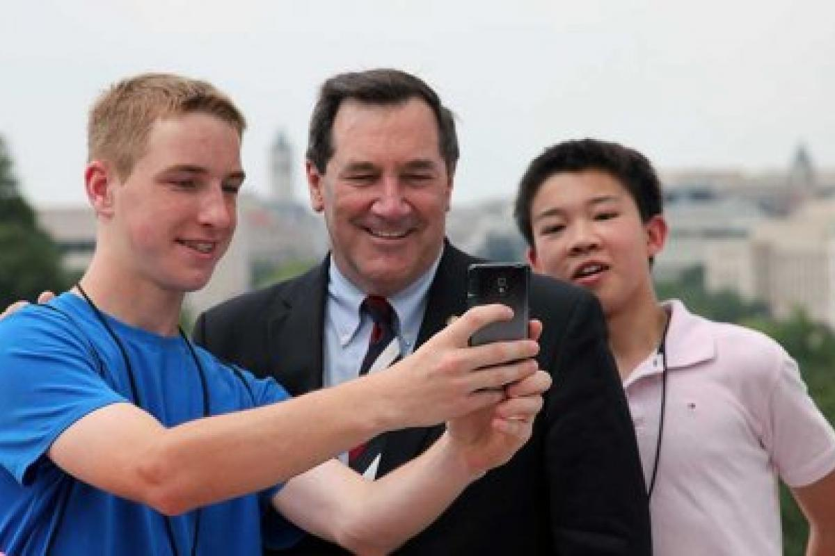 Senator Joe Donnelly of Indiana takes a selfie with Indiana National History Day
