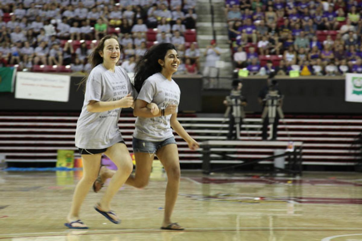 National History Day students run in arena to receive award