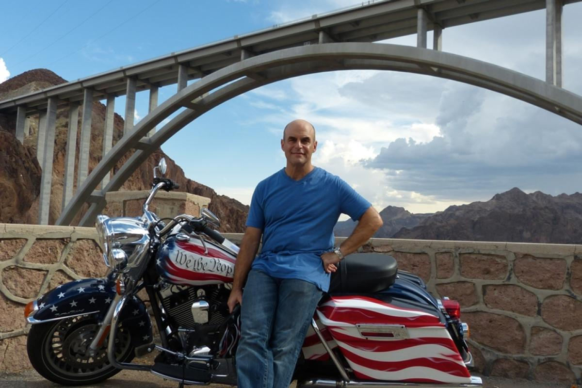 Peter Sagal, travels cross-country on a motorcycle.