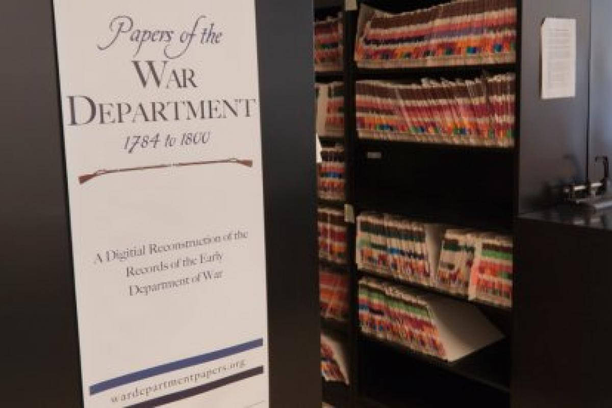 "Vertical banner titled, ""Papers of the War Department: 1784 - 1800,"" with an archive in the background filled with files."