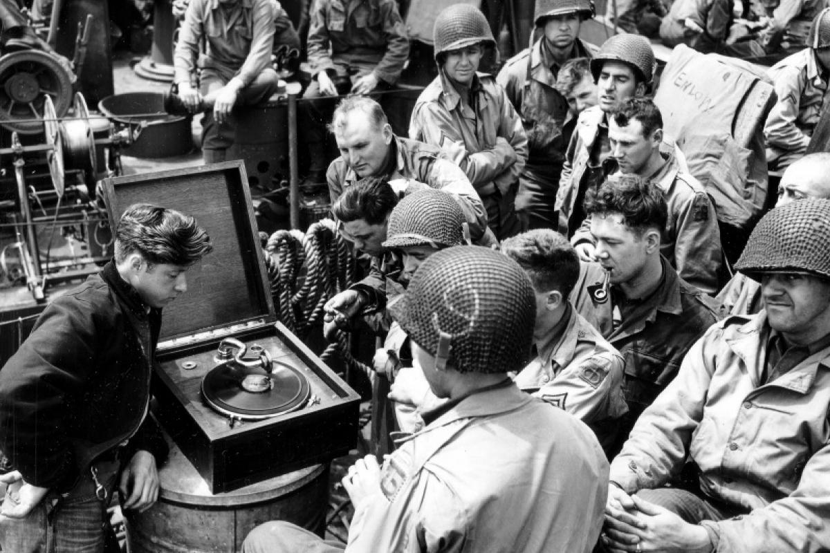 Soldiers listen to music on their way from England to Normandy, 1944
