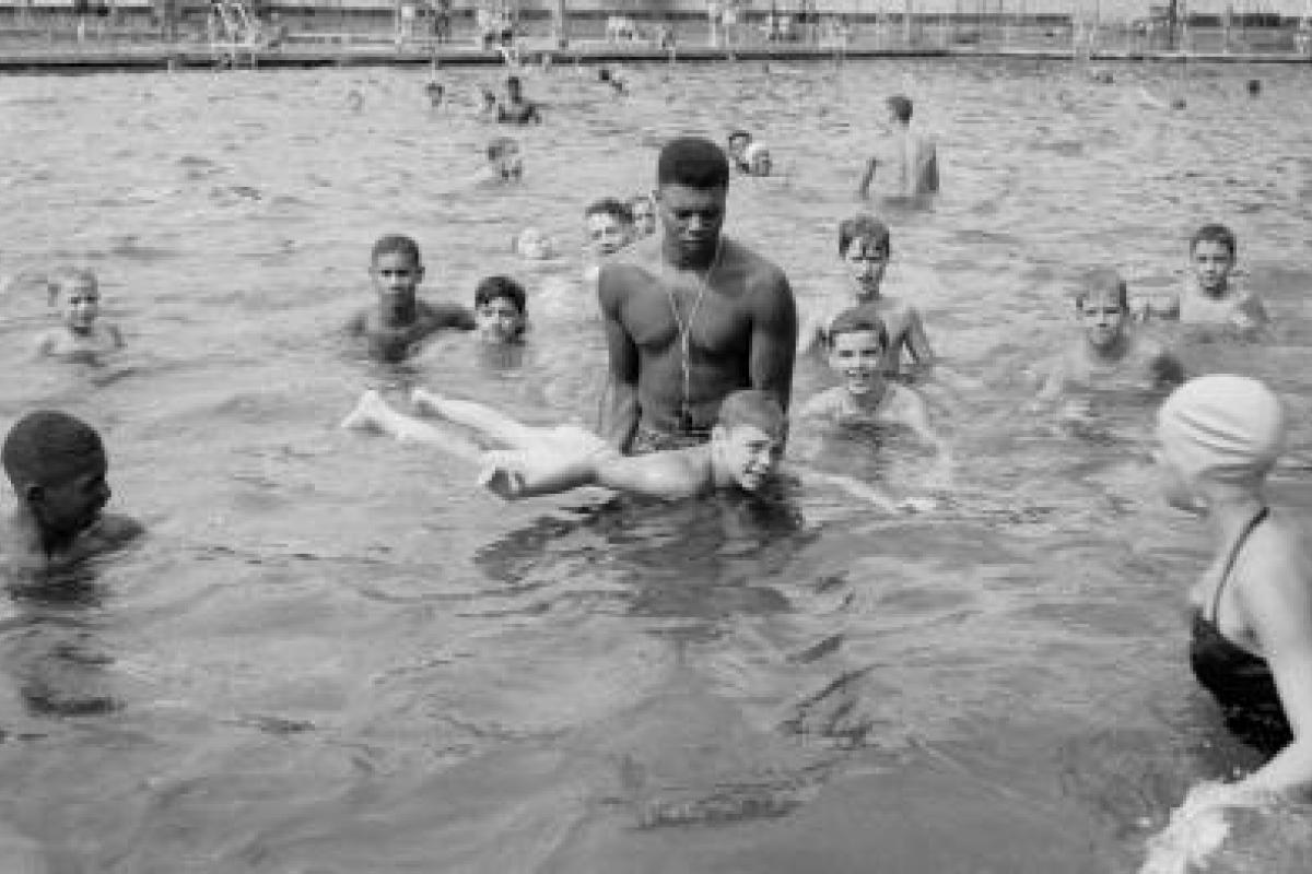 Lifeguard teaching boy to swim, Highland Park swimming pool 1951